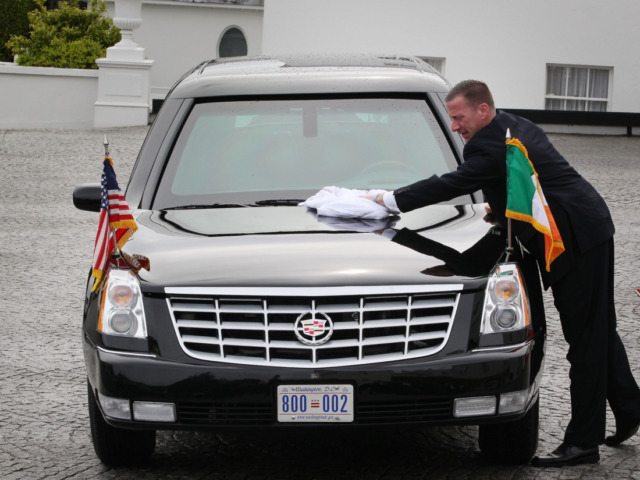 DUBLIN, IRELAND - MAY 23: A secret service agent wipes rainwater from US President Barack Obama's limousine at Áras an Uachtaráin on May 23, 2011 in Dublin, Ireland. U.S. President Obama is visiting Ireland for one day. He will meet with distant relatives in Moneygall and speak at a rally …