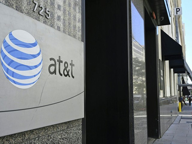 An AT&T telecommunication logo is seen at the entrance of a building in Washington, DC June 11, 2019. (Photo by EVA HAMBACH / AFP) (Photo credit should read EVA HAMBACH/AFP via Getty Images)