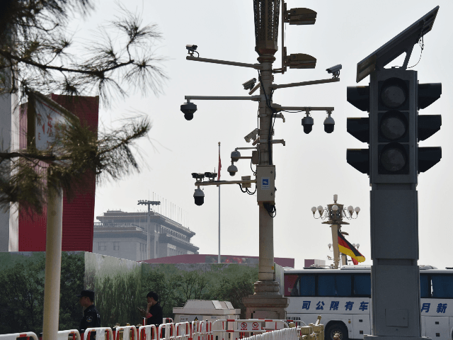Security guards patrol below surveillance cameras on a corner of Tiananmen Square in Beijing on September 6, 2019. - Some Beijing karaoke bars are closing, toy bombs are banned and every delivery package is being scanned: the capital is taking no chances weeks ahead of a massive military parade to …
