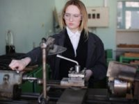 Young woman engineer working at machine tool manufacturing
