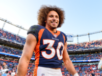 Phillip Lindsay #30 of the Denver Broncos smiles as he walks on the field after the Denver Broncos 16-0 win over the Tennessee Titans at Empower Field at Mile High on October 13, 2019 in Denver, Colorado. (Photo by Dustin Bradford/Getty Images)