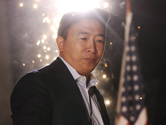 LOS ANGELES, CALIFORNIA - SEPTEMBER 30: Democratic presidential candidate, entrepreneur Andrew Yang stands at a campaign rally on September 30, 2019 in Los Angeles, California. Yang is the son of Taiwanese immigrants and was born in upstate New York. (Photo by Mario Tama/Getty Images)