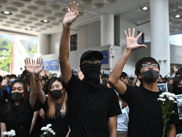 Students of the Hong Kong University of Science and Technology (HKUST) participate in a march towards HKUST president Wei Shyy's lodge in Hong Kong on November 8, 2019, following the death earlier in the day of student Alex Chow, 22, who was taken unconscious to hospital early on November 4 …