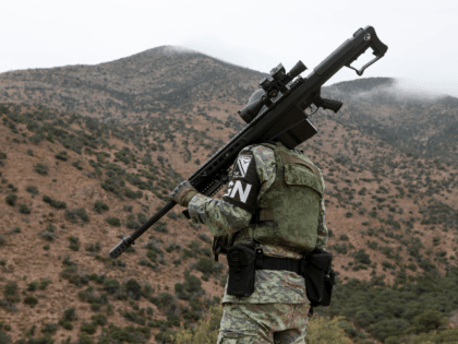 A member of the National Guard patrols the Sonora mountain range, where nine members of the LeBaron community were killed on Monday in the municipality of Bavispe, Sonora state, Mexico, on November 8, 2019. - The attack happened on an isolated dirt road in a region known for turf wars …