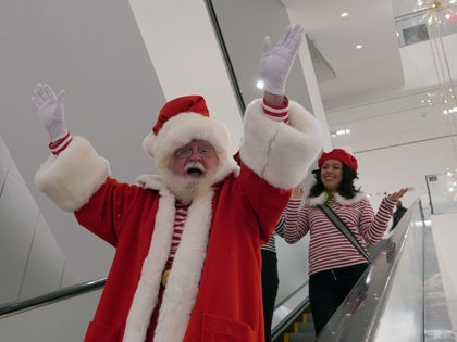 Santa Claus arrives down the esclolator at New York City's first-ever women's Nordstrom that spans seven stories on November 27, 2019 in New York City. (Photo by TIMOTHY A. CLARY / AFP) (Photo by TIMOTHY A. CLARY/AFP via Getty Images)
