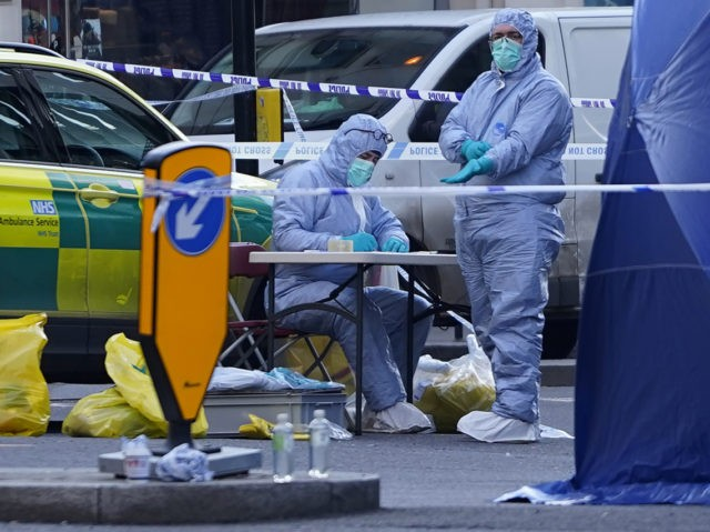 TOPSHOT - A forensics officer works outside a tent on Cannon Street near London Bridge in the City of London, on November 30, 2019, following the November 29 terror incident on London Bridge. - A man suspected of stabbing two people to death in a terror attack on London Bridge …
