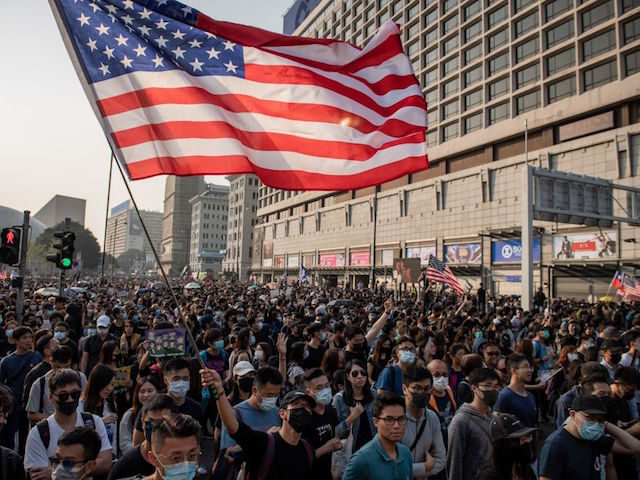 People take part in a march from the Tsim Sha Tsui district to Hung Hom in Hong Kong on December 1, 2019. - Tens of thousands of black-clad protesters flooded into the streets of Hong Kong on December 1, ending a brief election lull and demanding the government make concessions …