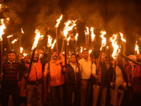 Krishak Mukti Sangram Samiti (KMSS) activists take part in a torch light procession to protest against the government's Citizenship Amendment Bill, in Guwahati on December 9, 2019. - India's parliament saw raucous scenes on December 9 and protests raged in the north-east of the country as MPs debated legislation that …