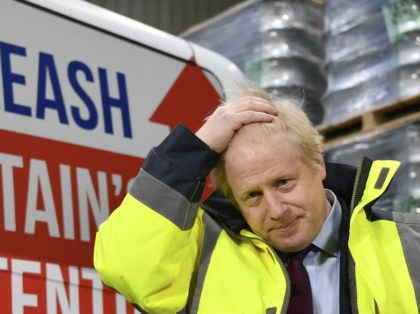 WASHINGTON, UNITED KINGDOM - DECEMBER 9: Britain's Prime Minister Boris Johnson speaks at a Q&A session during a general election campaign visit to Fergusons Transport December 9, 2019 in Washington, England. Britain will go to the polls on December 12, 2019 to vote in a pre-Christmas general election. (Photo by …