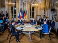 PARIS, FRANCE - DECEMBER 09: (L-R) Ukrainian President Volodymyr Zelensky, French President Emmanuel Macron, Russian President Vladimir Putin and German Chancellor Angela Merkel attend their summit on Ukraine at Elysee Palace on December 9, 2019 in Paris, France. The Normandy format was created in 2014 to resolve the conflict between …