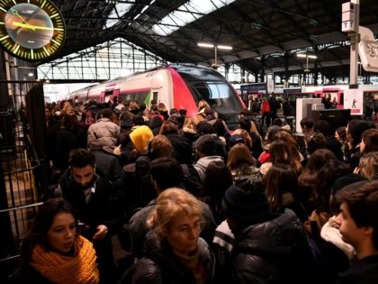 Commuters are seen at the Gare Saint-Lazare train station in Paris, on December 16, 2019, during a strike of Paris' public transports operator RATP and of the French state railway company SNCF employees over French government's plan to overhaul the country's retirement system. (Photo by Bertrand GUAY / AFP) (Photo …