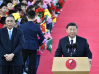 China's President Xi Jinping (R), with Macau's outgoing Chief Executive Fernando Chui (L), speaks upon his arrival at Macau's international airport in Macau on December 18, 2019, ahead of celebrations for the 20th anniversary of the handover from Portugal to China. - Chinese president Xi Jinping landed in Macau on …