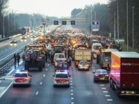 Dutch farmers use tractors to blockade the A9 Highway at Uitgeest, north of Amsterdam on December 18, 2019, as they protest a clampdown on nitrogen emissions that they claim could wreak havoc on their businesses. (Photo by Koen Van WEEL / ANP / AFP) / Netherlands OUT (Photo by KOEN …