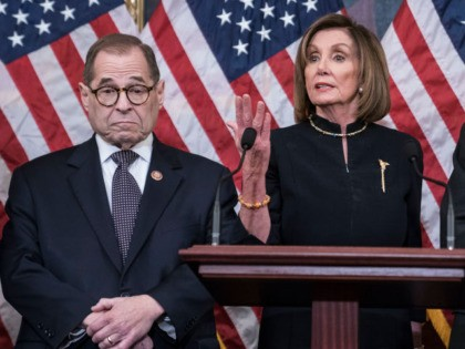WASHINGTON, DC - DECEMBER 18: Speaker of the House Nancy Pelosi (D-CA) delivers remarks alongside Chairman Jerry Nadler, House Committee on the Judiciary (D-NY) and Chairman Eliot Engel, House Foreign Affairs Committee (D-NY), following the House of Representatives vote to impeach President Donald Trump on December 18, 2019 in Washington, …
