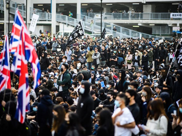 People attend a rally in Hong Kong on December 22, 2019 to show support for the Uighur minority in China. - Hong Kong riot police broke up a solidarity rally for China's Uighurs on December 22 -- with one officer drawing a pistol -- as the city's pro-democracy movement likened their plight to that of the oppressed Muslim minority. (Photo by Anthony WALLACE / AFP) (Photo by ANTHONY WALLACE/AFP via Getty Images)