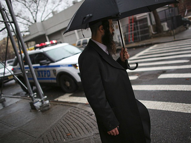 A NYPD car patrols in South Williamsburg Brooklyn on December 30, 2019 in New York City, two days after an intruder wounded five people at a rabbi's house in Monsey, New York during a gathering to celebrate the Jewish festival of Hanukkah. (Photo by Kena Betancur / AFP) (Photo by …