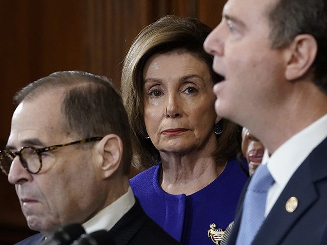 WASHINGTON, DC - DECEMBER 10: Speaker of the House Nancy Pelosi (D-CA) (C) listens as House investigative committee chairs Rep. Adam Schiff (R) (D-CA) and Rep. Jerry Nadler (L) (D-NY) announce the next steps in the House impeachment inquiry at the U.S. Capitol December 10, 2019 in Washington, DC. The …