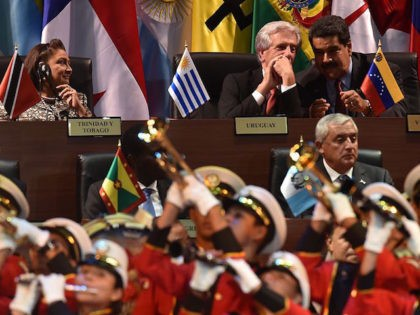 (L to R - top) Trinidad and Tobago's Prime Minister Kamla Persad-Bissessar, Uruguay's President Tabare Vazquez and Venezuela's President Nicolas Maduro and (L to R front) US President Barack Obama, Grenadian Prime Minister Keith Mitchell and Guatemala's Otto Perez attend the opening ceremony of the VII Americas Summit in Panama …