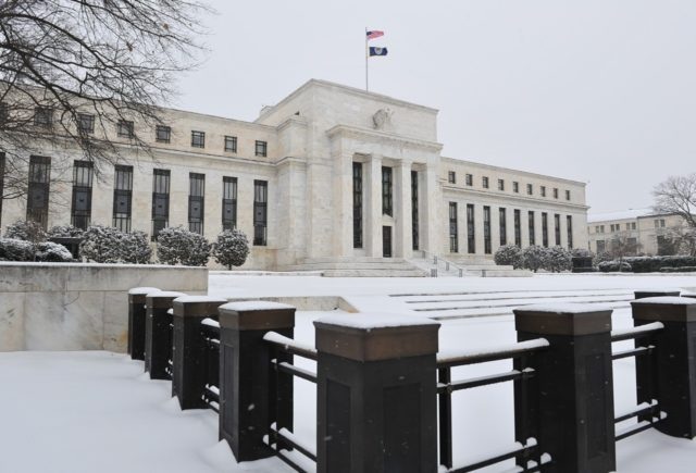 The US Federal Reserve is seen during a snow storm March 3, 2014 in Washington, DC. Snow began falling in the nation's capital early Monday, and officials warned people to stay off treacherous, icy roads a scene that has become familiar to residents in the Midwest, East and even Deep …