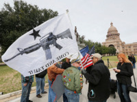 "AUSTIN, TX - JANUARY 1: On January 1, 2016, the open carry law took effect in Texas, and 2nd Amendment activists held an open carry rally at the Texas state capitol on January 1, 2016 in Austin, Texas. Armando Valledares of Killeen holds the ""Come And Take It"" flag. (Photo …"