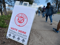 North Carolina State University students head to their precinct to vote in the primaries at Pullen Community Center on March 15, 2016 in Raleigh, North Carolina. The university provided bus transportation throughout the day to the precinct. The North Carolina primaries is the state's first use of the voter ID …