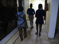 "Prostitutes leave an hotel in Benin City, capital of Edo State, southern Nigeria, on March 29, 2017. In Benin City, Nigeria's capital of illegal migration, no one says the word ""prostitution"". The word on the street for the young girls who leave for Italy or France is ""hustling"". About 37,500 …"
