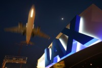 LOS ANGELES, CA - APRIL 15: A jet comes in for landing at Los Angeles International Airport (LAX) on April 15, 2008 in Los Angeles, California. With skyrocketing fuel prices and a weak economy, US airlines are turning to mergers which could ultimately lead to higher fares through reduced flights …