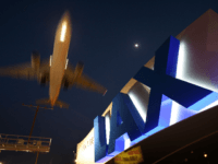 A jet comes in for landing at Los Angeles International Airport (LAX) on April 15, 2008 in Los Angeles, California. With skyrocketing fuel prices and a weak economy, US airlines are turning to mergers which could ultimately lead to higher fares through reduced flights and increased market power. US carriers …