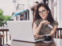 Businesswoman using laptop and credit card. Online shopping concept