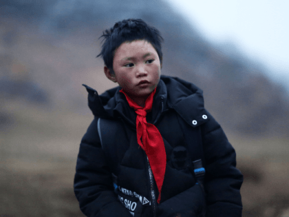 "This photo taken on January 11, 2018 shows Wang Fuman, also known as ""Frost Boy"", in Ludian in China's southwestern Yunnan province. A viral photo of a Chinese boy whose hair is encrusted with ice after his hour-long walk to school in freezing temperatures has stirred debate about the impact …"