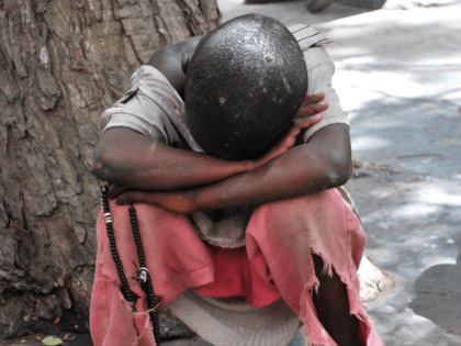 A street child known as 'Talibes' sleeps in a street in Dakar on April 16, 2010. At least 50,000 children attending hundreds of residential Quranic schools, or daaras, in Senegal are subjected to conditions akin to slavery and forced to endure often extreme forms of abuse, neglect, and exploitation by …