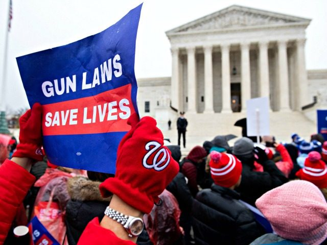 Supporters of gun control and firearm safety measures hold a protest rally outside the US Supreme Court as the Court hears oral arguments in State Rifle and Pistol v. City of New York, NY, in Washington, DC, December 2, 2019. - The case marks the first time in nearly 10 …