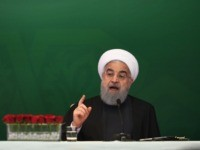 Iranian President Hassan Rouhani (R) delivers a speech to Muslims leaders and scholars as Iran Foreign Affairs Minister Mahamad Javad Zarief (L) listens at a meeting in Hyderabad on February 15, 2018. The Iranian President is on a three-day official visit to India. / AFP PHOTO / NOAH SEELAM (Photo …