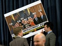 WASHINGTON, DC - DECEMBER 11: House Judiciary Committee staff members remove the signs after finishing the House Judiciary Committee markup of the articles of impeachment against President Donald Trump, December 11, 2019 in Washington, DC. The articles of impeachment charge Trump with abuse of power and obstruction of Congress. House …