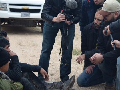Breitbart Texas's Brandon Darby and Ildefonso Ortiz interview a group of migrants recently apprehended by Border Patrol agents. (Photo: Bob Price/Breitbart Texas)