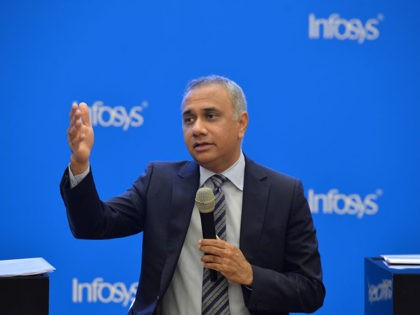 Indian CEO and Managing Director of Infosys Salil Parekh gestures while addressing a press conference held to announce the company's first quarter results in Bangalore on July 13, 2018. (Photo by MANJUNATH KIRAN / AFP) (Photo credit should read MANJUNATH KIRAN/AFP via Getty Images)