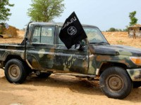 A vehicle allegedly belonging to the Islamic State group in West Africa (ISWAP) is seen in Baga on August 2, 2019. - Intense fighting between a regional force and the Islamic State group in West Africa (ISWAP) has resulted in dozens of deaths, including at least 25 soldiers and more …
