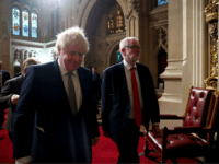 Britain's Prime Minister Boris Johnson (L) and Britain's Labour Party leader Jeremy Corbyn process through the Peers Lobby to listen to the Queen's Speech during the State Opening of Parliament at the Houses of Parliament in London on December 19, 2019. - The State Opening of Parliament is where Queen …