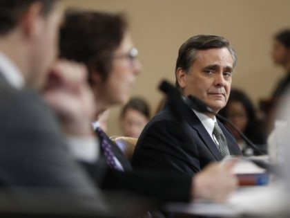 Jonathan Turley and others (Andrew Harnik / Associated Press)