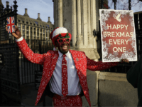 Joseph Afrane, a Brexit supporter protests against Britain being in the European Union, outside the Houses of Parliament in LondonWednesday, Dec. 18, 2019. Prime Minister Boris Johnson's decisive victory in last week's general election provided little comfort to Britain's once world-beating financial services industry, which has been battered by Brexit …