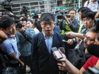 Pro-democracy activist Joshua Wong, who was disqualified from running, arrives to vote in the South Horizons district during local council elections in Hong Kong on November 24, 2019. - Hong Kong voted in district council elections in a ballot the city's pro-democracy movement hoped would send a message to the …