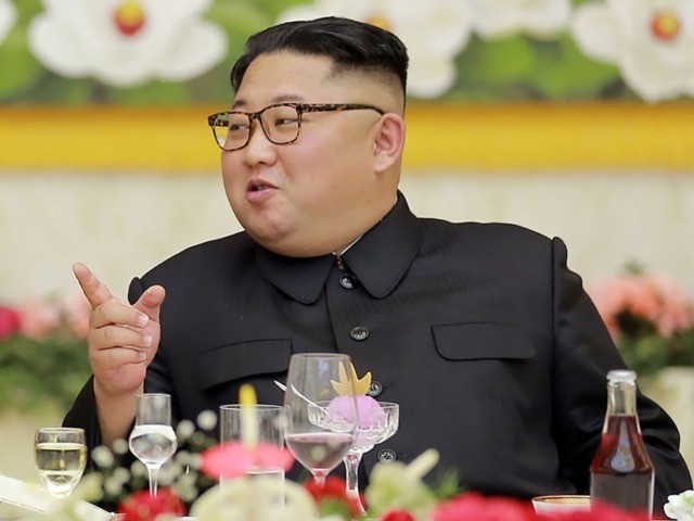 This photo taken on November 4, 2018 and released by North Korea's official Korean Central News Agency (KCNA) on November 5 shows North Korean leader Kim Jong Un (R) speaking with Cuba's President Miguel Diaz-Canel (L) during their banquet in Pyongyang. (Photo by KCNA VIA KNS / KCNA VIA KNS …