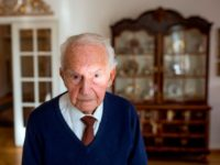Holocaust survivor Leon Schwarzbaum poses for a picture in his home in Berlin on December 4, 2019. - The 98-year old former Auschwitz inmate and survivor continues to speak out about the atrocities that took place at the concentration camp. German chancellor Angela Merkel will make her first visit as …