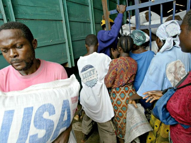 MONROVIA, LIBERIA - AUGUST 13: Hungry Liberians try to force their way into a warehouse full of U.S. supplied wheat at a World Food Program warehouse August 13, 2003 in Monrovia, Liberia. LURD (Liberians United for Reconciliation and Democracy) rebels in control of the port allowed civilians access to stocked …
