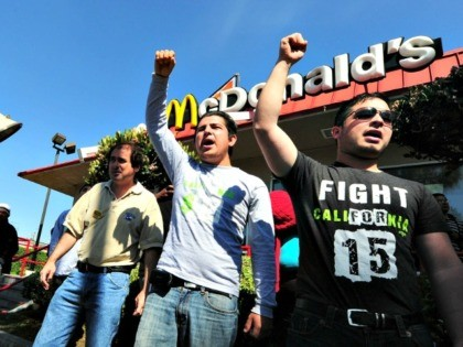 Protesters in front of a McDonald's in South L.A. where fast-food workers and their supporters gathered to protest wage theft in April 2014. Many fast-food restaurants like McDonald's say they have no control over hiring and firing decisions in franchises, making it difficult for unions to organize workers across a …
