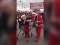 17-year-old Mena Hawkins with cerebral palsy walked across the finish line at the Las Vegas Great Santa Run. SOURCE: Roger Hawkins