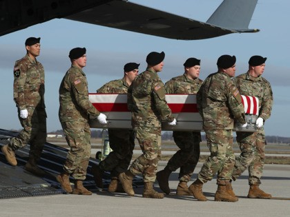 DOVER, DELAWARE - DECEMBER 25: A U.S. Army carry team moves the transfer case containing the remains of U.S. Army Sgt. 1st Class Michael Goble during a dignified transfer at Dover Air Force Base, December 25, 2019 in Dover, Delaware. Sgt. Goble who was from Washington Township, N.J., was killed …