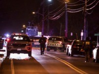 Authorities gather on a street in Monsey, N.Y., Sunday, Dec. 29, 2019, following a stabbing late Saturday during a Hanukkah celebration. A man attacked the celebration at a rabbi's home north of New York City late Saturday, stabbing and wounding several people before fleeing in a vehicle, police said. (AP …