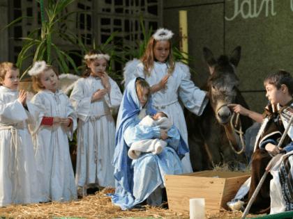 Children perform a nativity scene on Christmas Eve at the Saint-Liboire Church in Le Mans, western France, on December 24, 2017. / AFP PHOTO / JEAN-FRANCOIS MONIER (Photo credit should read JEAN-FRANCOIS MONIER/AFP via Getty Images)