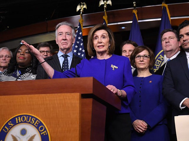 Speaker of the House Nancy Pelosi and House Ways and Means Committee Chairman Richard Neal(L), Democrat of Massachusetts, speaks about the US - Mexico - Canada Agreement, known as the USMCA, on Capitol Hill in Washington, DC, December 10, 2019. - Officials from the US, Canada and Mexico will meet …